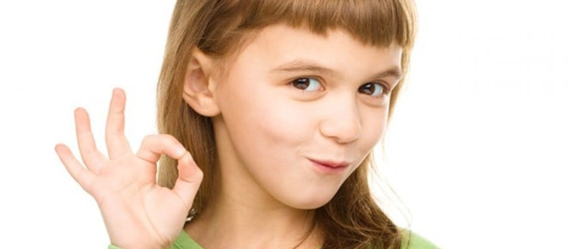 bigstock-Happy-little-girl-is-showing-O-60649085